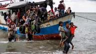 Locals evacuate Rohingya refugees from a boat at a coast of North Aceh, Indonesia, June 25, 2020 in this photo taken by Antara…