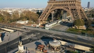 FILE PHOTO: An aerial view shows the deserted Eiffel tower in Paris during a lockdown imposed to slow the spread of the…
