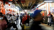 People are pictured at Central de Abastos, one of the world's largest wholesale market complexes, as the coronavirus disease …