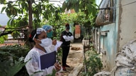 Doctors take a walking round at the low-income neighborhood of Las Mayas, as cases rise amid the coronavirus disease (COVID-19)…