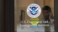 A security guard watches over a closed door at an immigration office in New Jersey.