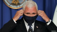 U.S. Vice President Mike Pence takes off his protective face mask to speak as he leads a White House coronavirus disease (COVID…
