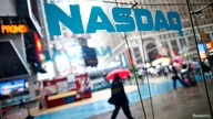 Pedestrians walk past the NASDAQ MarketSite in New York's Times Square in this June 4, 2012 file photo. Long frustrated about…