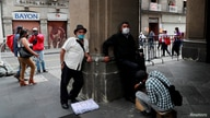 A man has his shoes shined near the Zocalo Square, as the coronavirus disease (COVID-19) outbreak continues, in Mexico City,…