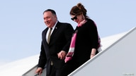 U.S. Secretary of State Mike Pompeo arrives with his wife Susan Pompeo at the airport in Prague, Czech Republic, August 11,…