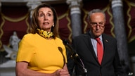 House Speaker Nancy Pelosi of Calif., left, speaks as she stands next to Senate Minority Leader Sen. Chuck Schumer of N.Y.,…