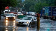 A man checks on a stranded vehicle during Tropical Storm Isaias, Tuesday, Aug. 4, 2020, in Philadelphia. The storm spawned…