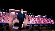 President Donald Trump walks to the stage after Vice President Mike Pence delivered a speech on the third day of the Republican…
