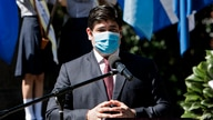 Costa Rican President Carlos Alvarado wears a face mask as he delivers a speech during the commemoration of the 199th…