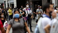 People walk on a busy street after President Nicolas Maduro's government decided to ease the lockdown due to the coronavirus…