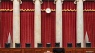 An interior view of the Supreme Court shows the bench draped with black bunting in honor of the late Justice Ruth Bader…