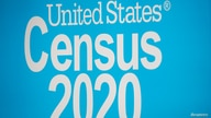 A sign is seen during a promotional event for the U.S. Census in Times Square in New York City, New York, U.S., September 23,…