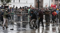 Protesters place barricades in the Plaza de Santo Domingo near the government palace during a protest to reject the government…