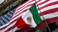 The flag of Mexico changes in front of a large U.S. flag in front of the New York Stock Exchange September 4, 2015.  REUTERS…
