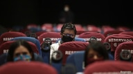 """People wearing protective face masks are seen inside movie theater """"Cineteca Nacional"""" during the gradual reopening of…"""