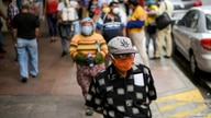 FILE PHOTO: People walk on a street in Guayaquil, Ecuador, in May, amid the outbreak of the coronavirus disease (COVID-19), May…