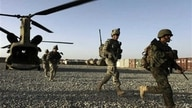 FILE - U.S. infantrymen from the 101st Airborne Division and Afghan Army commandos exit a U.S. Army helicopter in Afghanistan's southern Kandahar province, Sept. 11, 2010.