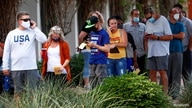 People line up to cast their vote at a polling station on Election Day in Surprise, Arizona, U.S., November 3, 2020. REUTERS…