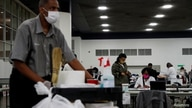 Votes continue to be counted at the TCF Center the day after the 2020 U.S. presidential election, in Detroit, Michigan, U.S.,…