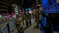 National Guard members stand guard near Philadelphia City Hall after police probing an alleged plot to attack vote counting…