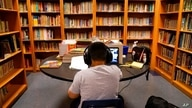 FILE - A Los Angeles Unified School District student attends an online class at Boys & Girls Club of Hollywood in Los Angeles, Aug. 26, 2020.