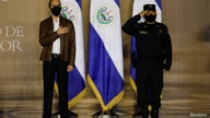 El Salvador President Nayib Bukele and the National Civil Police's chief Mauricio Arriaza Chicas take part in a promotion…