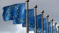 FILE PHOTO: European Union flags flutter in front of the European Commission headquarters in Brussels, Belgium, October 2, 2019…