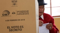 A men casts his vote during a constitutional referendum called by President Lenin Moreno in Quito, Ecuador, Sunday, Feb. 4,…
