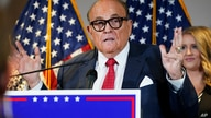 FILE - In this Nov. 19, 2020, file photo, former New York Mayor Rudy Giuliani, a lawyer for President Donald Trump, speaks…
