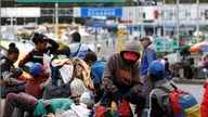Venezuelans wait to cross the border between Colombia and Ecuador after Ecuador's government on Saturday announced the closure…