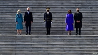 High winds forces a hat to blow by US President Joe Biden, First Lady Jill Biden, US. Vice President Kamala Harris and First…