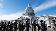 Members of the U.S. National Guard arrive, as the U.S. Capitol goes into lockdown during the dress rehearsal ahead of U.S…