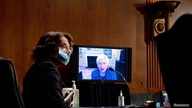 Senator Dianne Feinstein (D-CA) listens to Janet Yellen give her opening statement via videoconference during a Senate Finance…