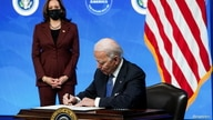 U.S. President Joe Biden signs an executive order after speaking about his administration's plans to strengthen American…