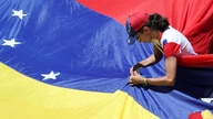 A supporter of Venezuelan opposition leader Juan Guaido, who many nations have recognized as the country's rightful interim…