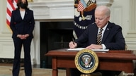 U.S. President Joe Biden signs an executive order, aimed at addressing a global semiconductor chip shortage, as Vice President…