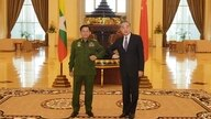 Myanmar's Army Commander and now the country's military leader, Gen. Min Aung Hlaing, left, and Chinese Foreign Minister Wang Yi pose for a photo during their meeting in Naypyitaw, Myanmar, Jan. 12, 2021. (Myanmar Military Information Team via AP)