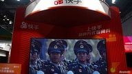 A screen showing footages of the military parade marking the 70th founding anniversary of People's Republic of China on October…