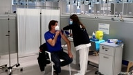 A nurse administers a dose of AstraZeneca's coronavirus disease (COVID-19) vaccine, as Spain resumes vaccination with…