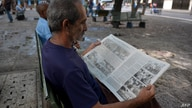 A man reads Cuban newspaper Juventud Rebelde (Rebel Youth) in Havana, on May 19, 2018 a day after a plane crashed shortly after…