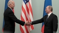 FILE PHOTO: Russian Prime Minister Vladimir Putin (R) shakes hands with U.S. Vice President Joe Biden during their meeting in…