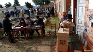 People vote in the regional elections, in Sica Sica, Bolivia April 11, 2021. REUTERS/Manuel Claure