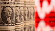 FILE PHOTO: U.S. One dollar banknotes are seen in front of displayed stock graph in this illustration taken, February 8, 2021…