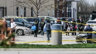 Investigators are on the scene following a mass shooting at a FedEx facility in Indianapolis, Indiana, U.S., April 16, 2021. …