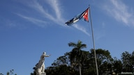 A statue of 19th century Cuban independence leader and poet Jose Marti and the Cuban flag are seen in the Parque Central of…