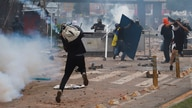 Demonstrators clash with members of the security forces during a protest against what they say was police brutality exerted in…