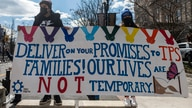 Activists and citizens with temporary protected status (TPS) march along 16th Street toward the White House in a call for…