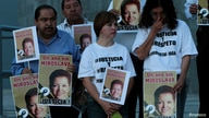 Journalists hold signs with pictures of their colleague Miroslava Breach during a protest to mark the first anniversary of her…