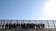 A group of Central American migrants surrenders to U.S. Border Patrol Agents south of the U.S.-Mexico border fence in El Paso,…