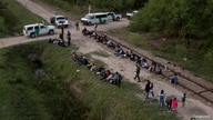 FILE PHOTO: Dozens of asylum-seeking migrants from Romania, Armenia, and Central America, including a group of unaccompanied…